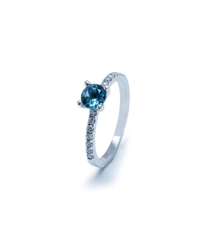 Anell or blanc amb topaci blau i diamants